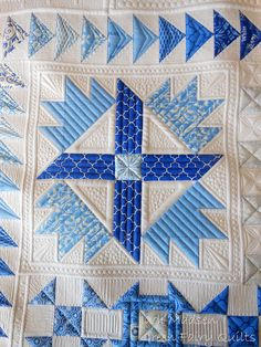 Quilting by Judi Madsen.  Pieced quilt by Kimberly Einmo.