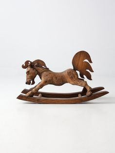 vintage hand-carved wood rocking horse A one of a kind rare find! This wood folk art rocking horse was meticulously hand carved. The horse was crafted