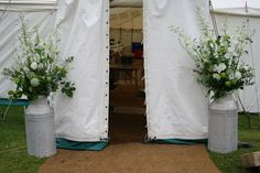 Milk churns at the entrance to the marquee The Blossom Tree: White and Green Country Wedding