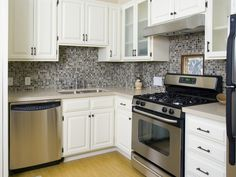 White cabinets and tile backsplash