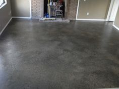 My best DIY project yet! I painted my concrete floor. 2 cans of lowes concrete and floor paint in gray for the primer, 3 quarts of paint( 1 gray beige, 1 dark brown black undertone, and 1 can of amber brown) 1 container of glaze, a Basement Concrete Floor Paint, Concrete Floor Paint Colors, Painted Cement Floors, Painting Basement Floors, Painting Cement, Basement Flooring, Diy Flooring, Basement Remodeling, Floor Painting