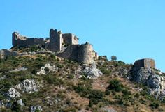 The Château d'Aguilar is a 12th century Cathar castle located in the commune of Tuchan in the Aude département of France.  In 1210 it was seized and occupied by Simon de Montfort, whose soldiers held the owner Raymond de Termes in prison in Carcassonne. Militarily, the castle lay dormant for the next 30 years, until Raymond's son Olivier de Termes won back the castle in the brief revolt by the young Viscount Trencavel against the crusaders. Aguilar became the refuge of faidits, Cathar…