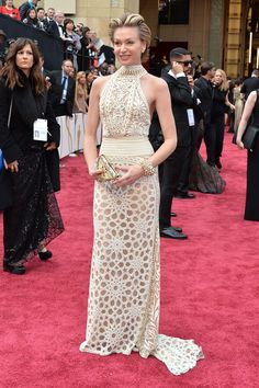 Portia de Rossi – Naeem Khan ivory honeycomb-beaded halter gown, Brian Atwood shoes, Fendi purse and Dior jewelry