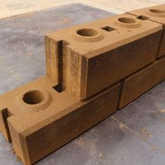 This article will discuss what interlocking bricks are, the advantages and disadvantages of using them and whether they are good for construction. - click for 3 min read Earth Bag Homes, Brick Material, Interlocking Bricks, Earthship Home, Solid Brick, Brick Construction, Brick Molding, Building Stairs, Brick Design