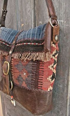kinda lovin' this.The Buffalo bag messenger bag. Vintage kilim, Hmong indigo, bridle leather and old coins. Fully lined with African mud cloth. Estilo Hippie, Hippie Chic, Hippie Style, Tribal Style, Hippie Bohemian, My Bags, Purses And Bags, Look Boho Chic, Carpet Bag