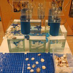 Construction and designed center: Plexi glass, glass blocks, tin cans, sea shells, tile mats.