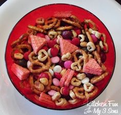 Valentine snack mix...love the little sugar wafer triangles!!  Same site also has another mix for Valentine's Day with: 4 cups miniature pretzels  4 cups Strawberry Yogurt Cherrios (or favorite cereal)  3 cups (1 box) Chocolate Teddy Grahams  2 cups dried cherries or cranberries  2 cups yogurt covered raisins  2 cups Valentine M  That was cute.