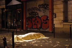Paris. Nov. 13, 2015. A victim outside the Bataclan theater, where 90 people were killed during coordinated terrorist attacks that left 40 more dead across the city and in a northern suburb.  CreditJerome Delay/Associated Press