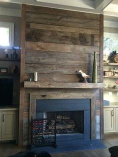 Reclaimed wood fireplace... it would be easy to cover the ugly brick with this and cheap but beautiful!!