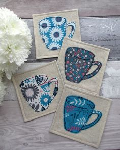 This set of 4 mug coasters are made with 4 coordinating floral fabrics with a retro yet modern feel! Each of the coasters have a mug appliqued in cotton fabrics using a free motion machine embroidery technique. The coasters measure approx x Scrap Fabric Projects, Fabric Scraps, Quilting Projects, Sewing Projects, Craft Projects, Sewing Tutorials, Project Ideas, Sewing Hacks, Mug Rug Patterns