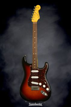 New toy - Fender John Mayer Signature Stratocaster - 3-Color Sunburst.  Will be changing the pickguard and covers though.  This thing kicks ass.