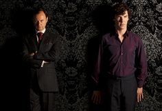 Mycroft is all sulky in this photograph because he is jealous that his little brother has a purple shirt of sex and looks damn good in it, whereas Mycroft has neither  >.