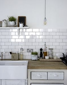 I heart white subway tile, wood counter tops and farm sinks.