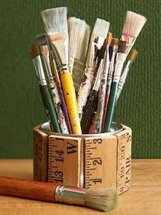 An old tin can and a wooden ruler make a perfect pen or brush holder - made to measure!
