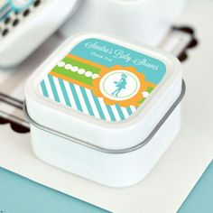 "Going to Pop - Blue Personalized Square Candle Tins. Add to the sweet ambiance of your baby shower with some ""She's Going to Pop!"" Square Candle Tins. Included with your white candles are personalized labels in bright hues of blue and green featuring a stylish mommy-to-be silhouette design, perfect for a fashionista expecting a baby boy.  Use as a fragrant accessory for your event as well as a memorable thank you gift for loved ones.  Due to the personalization for this product, the…"