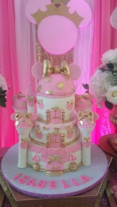 Pink and gold cake at a royal Minnie Mouse birthday party! See more party planning ideas at CatchMyParty.com!
