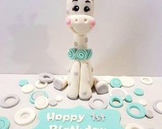 Giraffe Baby Birthday Cake Topper with matching Happy Birthday name plaque and retro spots decorations