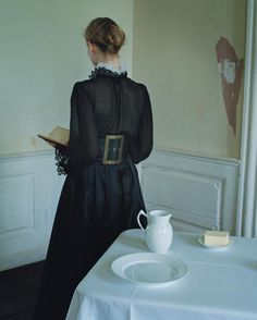 "Danish model reading in ""To Denmark, With Love"" for W Magazine, December 2016. Photograph by Tim Walker. ""A Golden Age. No one depicted Danish interior life—in its seeming tranquility and actual complexity—like the artist Vilhelm Hammershøi (1864–1916), whose paintings often featured a lone woman with her back turned to the viewer. Sand Copenhagen shirt; Burberry top (underneath); Maggie Norris Couture skirt; Philosophy di Lorenzo Serafini belt."""