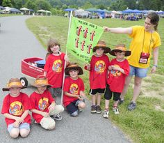 Tiger Den 3 Scouts with their den flag as they pose for the camera during the Harford County District Cub Scout Day Camp at the Harford County Equestrian Center Tuesday. Day Camp, Pose For The Camera, Tiger Cubs, Cub Scouts, Equestrian, Den, Tuesday, Flag, Camping
