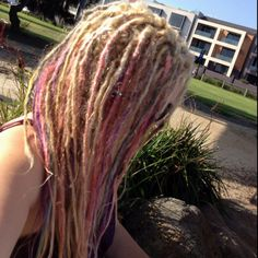 My Pastel Dreadlocks Rainbow Blond Dreads. I used Manic Panic dyes that started out really bright and eventually faded into this pastel colour. Not the best photo but it is all blonde at the top and pastels down the lengths.
