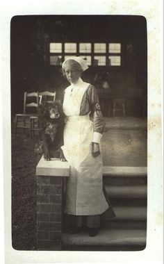 An unknown VAD Nurse and Dog - Kettering Hospital, England, 1916.