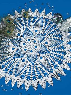 Ravelry: Peacocks and Pineapples Doily pattern by Josie Rabier