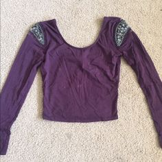 Jeweled sleeve crop top Long sleeve crop top with jeweled sleeves. Only worn once. Hits right above your belly button Urban Outfitters Tops Crop Tops