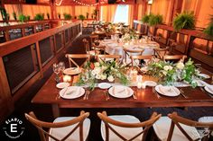 Beautiful rustic tablescape at a wedding reception at Fasig Tipton. Photo Credit - Elario Photography