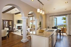 i love everything about this picture, the floors, the entrance into the kitchen, the granite color, the cabinet color!
