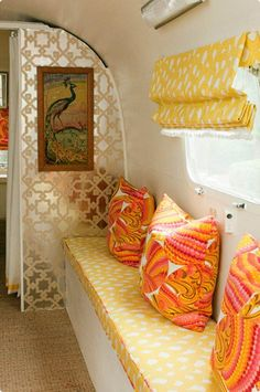 love this color scheme and wallpaper for a vintage camper // so cozy