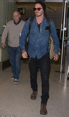 David Beckham and father Ted are casual travelers at LAX #dailymail