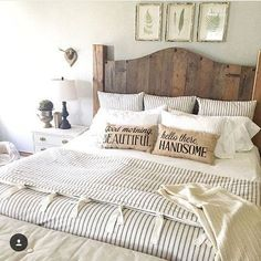 The pillows.  I love the worded pillows. ❤ (Ticking stripe bedding. Farmhouse bedding. Duvet. Wood headboard)