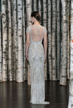 The sheer back on this bejeweled gown from Naeem Kahn spring 2015 bridal collection is so stunning.