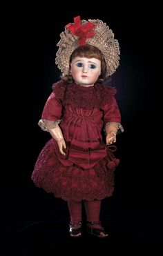 "Pretty French Bisque Bebe Steiner,Figure A,with Original Dress and Bonnet  16""(41 cm.) Marks: J.Steiner Bte SGDG Paris Fre A 9 (head) (paper label with illustration of doll and 1889 flag). Comments: Jules Steiner,circa 1890."
