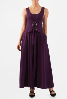 Our cotton knit maxi dress with a low scoop neckline and flared skirt is cinched with wide lace-up corset banding.