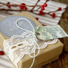 - stickers, lace, scrap book cut outs and kraft boxes -