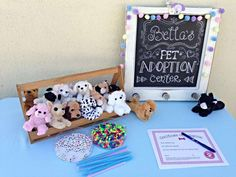 cute idea = adopt a pet and then fill out the adoption certificate as well as make it a collar with its name.