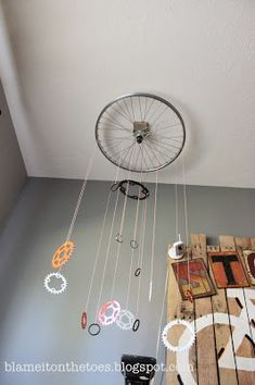 DIY Mobile made out of bicycle wheel and gears. Orange and Gray Vintage Bicycle Nursery