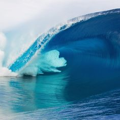 """#StillCommunication: """"This image sums up why I love Teahupo'o and how it captivated me enough to move here six years ago. It is such a perfectly beautiful wave, but so very scary at the same time. There's so much power in the ocean folding into itself."""" – @dmosqphoto is one of the greatest photogs in French Polynesia, and this is one of his best captures of the jewel in the local surfing crown."""