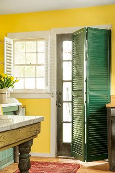Salvaged folding shutters add privacy to this back door entrance.