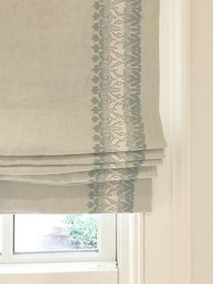 Linen roman shade with blue and cream embroidered detail in kitchen of Southeastern Designer Showhouse 2017