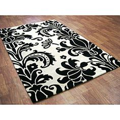 @Overstock - Breathe new life into your home decor with a hand-tufted wool rug  Area rug features a transitional floral pattern  Shades of white and black highlight rug with elegancehttp://www.overstock.com/Home-Garden/Hand-tufted-Floridly-Black-Wool-Rug-5-x-8/4300691/product.html?CID=214117 $186.99