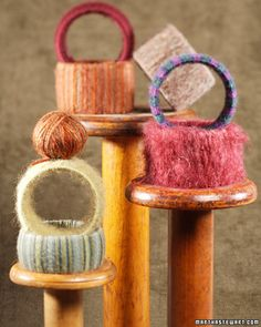 Using the empty tape (scotch & packing) spools from our preschool class and varigated yarn my 3-5 yr. olds love this project! Buttons are a nice addition as well.
