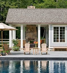 a dream backyard, complete with outdoor fireplace and charming pool house.