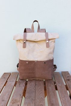 Handcrafted of the natural color waterproof canvas and beige nubuck (leather) with leather details. Size: 42х27х12 cm. Two external leather (nubuck) pockets with snap fasteners. Two pockets...