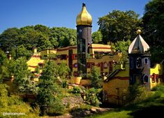 """This building is the work of artist, designer and architect Hundertwasser. It's a guest house for the parents of seriously ill children in the nearby hospital in Essen, Germany. Hundertwasser said, """"When one creates green roofs the houses themselves become part of the landscape."""" More green roofs at www.naturalhomes.org/greenroofs.htm"""