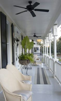 This porch is too shallow...but I like the grey painted floor. I have always pictured a deep porch with grey wood floor and pale blue ceiling, fans, railing, rockers, mint julep...