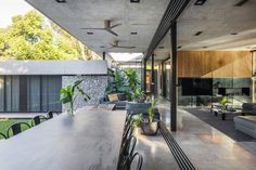Image 9 of 37 from gallery of BT House / Estudio Jorgelina Tortorici Arq. Photograph by Alejandro Peral Residential Architecture, Architecture Design, Metal Shutters, Raised House, Concrete Structure, Ground Floor Plan, Architect House, Tropical Houses, Facade
