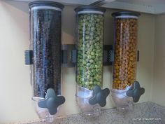 Use a Wall Mounted Cereal Dispenser [$ 35.10 for 3-pack] as a dry food dispenser : fill with often used items such as cold cereal, oatmeal, pasta, beans, pet food, etc... space saving + convenient!