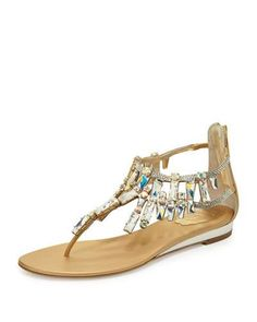 5927aa4126b Rene Caovilla metallic lambskin sandal with large Swarovski crystal trim. T- strap vamp. Back zip eases dress. Leather lining. Made in Italy.